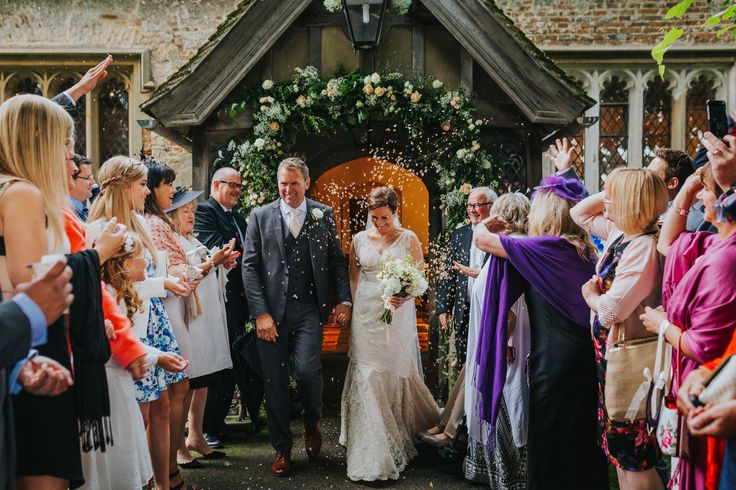 We're married! Lovely confetti shot of the newlyweds coming out of Rotherwick Church. Photo by Benjamin Stuart Photography #weddingphotography #confetti #newlyweds #brideandgroom #churchwedding