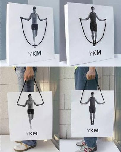 YKM Bag Advertisement.Found this to be a fun and creative way to use the bag handles.