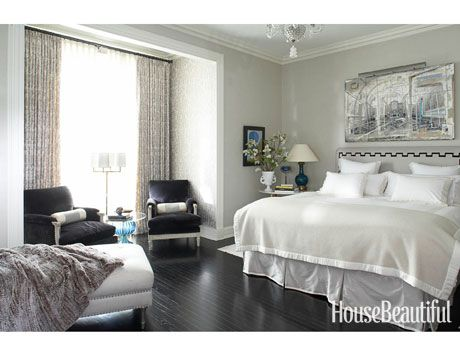 This bedroom has a cool, collected feeling with its soft, silvery colors and ebonized floor. Designer: Alessandra Branca
