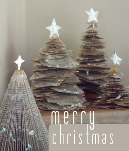 Christmas trees made out of folded books and torn paper.