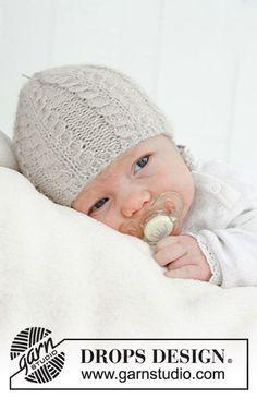 Bonnet tricoté pour bébé, avec torsades, en DROPS Puna. Du 0 mois – 4 ans..
