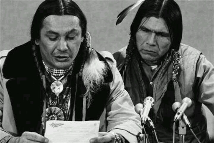 Remembering the Wounded Knee incident, Feb. 27, 1973 --pictured, Russel Means (speaking) and Dennis Banks of AIM