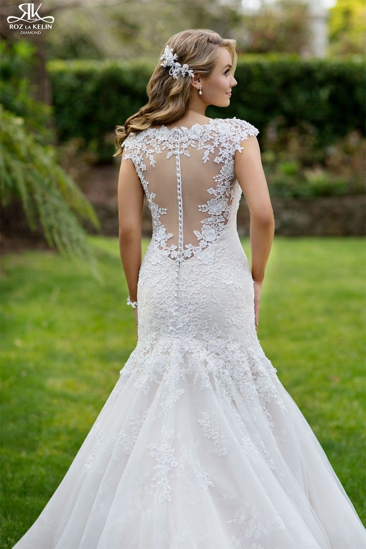 Villena 5992T: With the lace and mesh feature back the Villena gown is a great statement wedding gown. From the Diamond collection this is gown is nothing short of stunning with a finish of a textured tulle train.