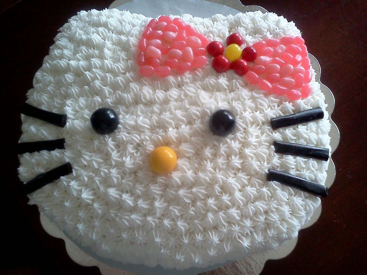 Hello Kitty Cake, without mold Made w/ 11x14 pan, cut oval from a platter as template, used remaining cake scraps to make ears