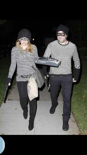 Couples costume robbers