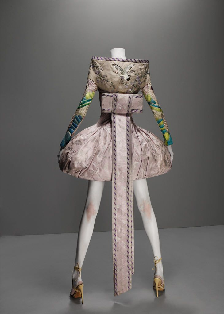 It's Only a Game, spring/summer 2005  Dress and obi-style sash of lilac and silver brocade; jacket of lilac silk faille embroidered with silk thread; top of nude synthetic net embroidered with silk thread  Dress courtesy of Alexander McQueen