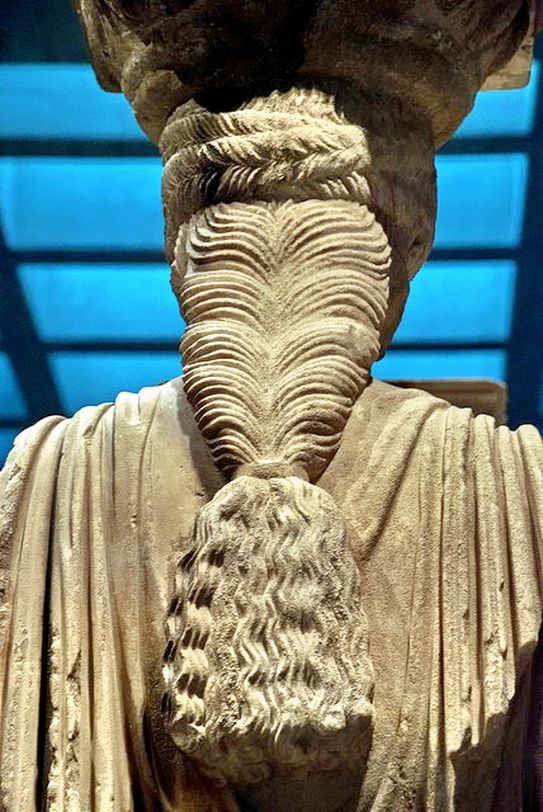 Ancient Greek hairstyle as seen on one of the Karyatides column statues, which is one of the exhibits in the Athens Acropolis museum.