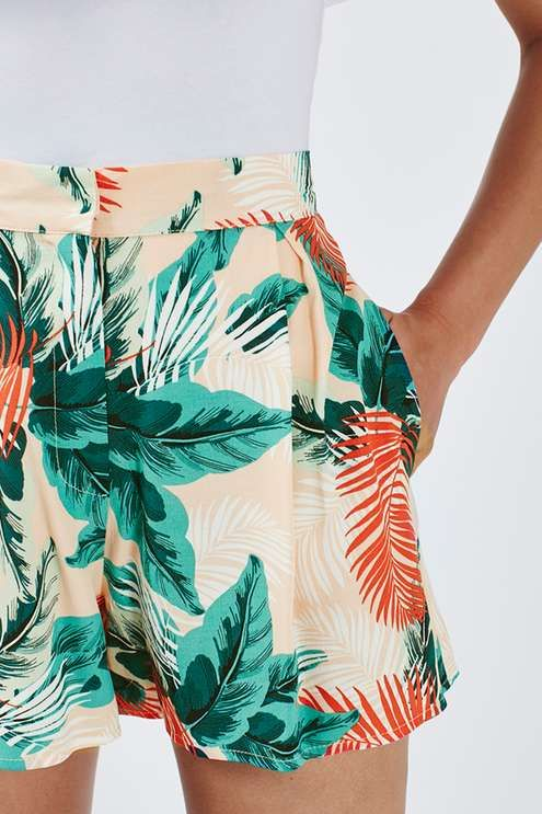 Channel festival-cool with these relaxed fit shorts. Sitting high on the waist for a flattering fit, we're loving the all-over palm print giving a subtle pop of colour. With a concealed fastening to the front, they come detailed with practical side pockets. Style back with this season's quintessential cold shoulder silhouette and sliders to finish the look. #Topshop