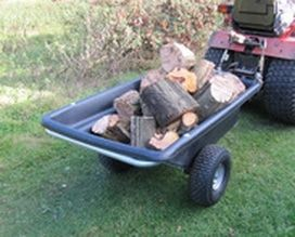 Smallholder trailer with logs,. For more info: http://www.fresh-group.com/trailers-trolleys-and-carts.html
