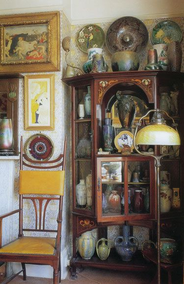 To run a little antique shop filled with art pottery and art glass