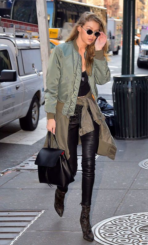 Gigi Hadid showed us how to layer like a pro: wear a bomber jacket and tie another one around your waist. The model paired her jackets with black leggings, printed booties, and black sunglasses.