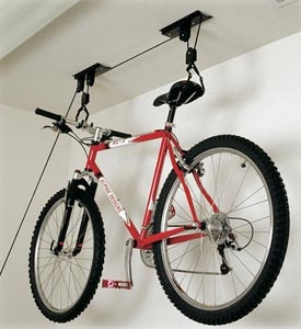 The Hoist Monster Bike Storage Rack works just like your miniblinds- just pull on the rope to raise and lock the bike in the air, loosen the rope to lower it!