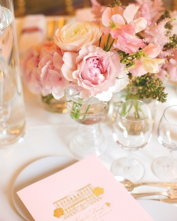 Simple centerpieces of peonies, ranunculus, and astilbe