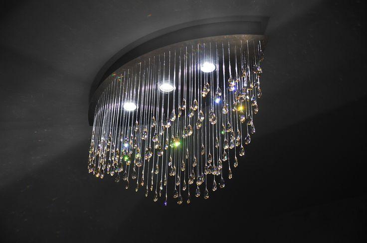 Modern chandelier made of crystals hanging on sparkling fiber optics. Night mode. MADE WITH SWAROVSKI ELEMENTS.