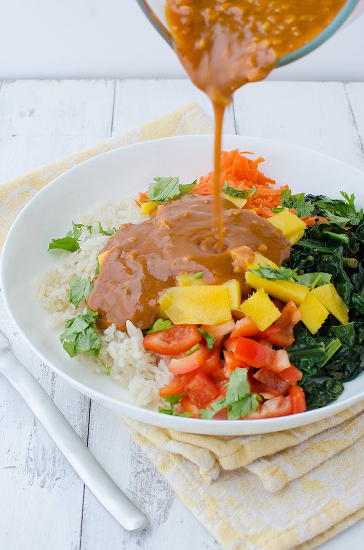 Vegan and Gluten Free Thai Curry Bowls! Layers of rice, mango, kale, carrots, peppers and the BEST red curry thai sauce! | www.delishknowledge.com