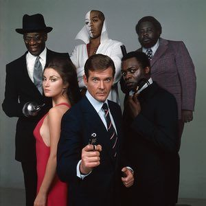 Roger Moore as James Bond, Jane Seymour as Solitaire, Julius Harris as Tee Hee, Geoffrey Holder as Baron Samedi, Earl Jolly Brown as Whisper and Yaphet Kotto as Kananga in Live And Let Die, 1973