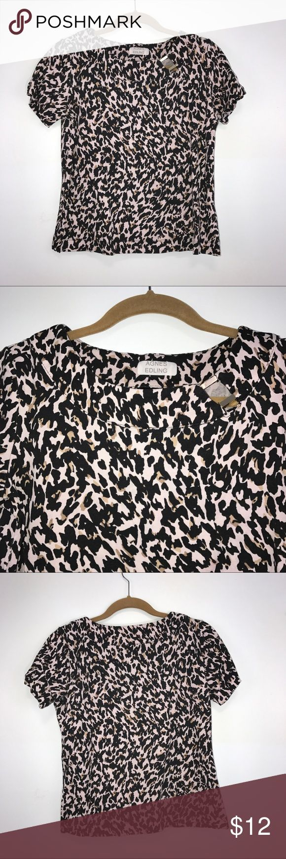 "Rafaella Black Tan Animal Print Woman's Top M Rafaella Black and Tan, Animal Print Top. Has gold bars on neckline. Lying flat, approximate measurements are:  bust 21""; waist 20""; hip 21""; length 21"". (L01-09)     🌼 No holes, piling or stains. Items stored in smoke free, pet free, perfume free environment. No trades or modeling. Same or next day shipping.  Save by bundling. All offers should be submitted with the offer button. Rafaella Tops"