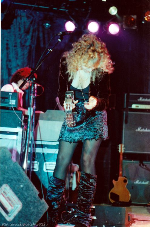 Stevie wearing a velvet mini skirt and matching velvet leg warmers rocking out on a tambourine during the Bob Welch special.