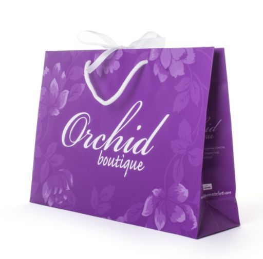 #colourfulbags #boutiquebags #luxurybags #carrierbags This bright colour bag with subtle pattern is classy and elegant.  This design was created for Orchid Boutique.