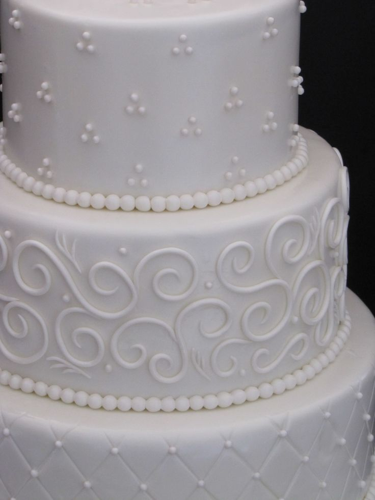 Elegant Three Tier Wedding Cake - This three tier wedding cake was an off white cake with a monotone look.  It was my first try with the quilting effect.  TFL!!