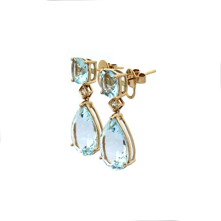 These stunning and elegant drop earrings are made from eye clean Aquamarine cushion cut and pear shape gemstones.