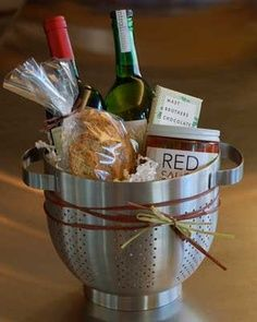 LOVE THIS IDEA!!  Spaghetti dinner housewarming gift...love using the colander as a basket!