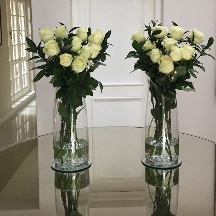 White rose centerpiece with ruscus