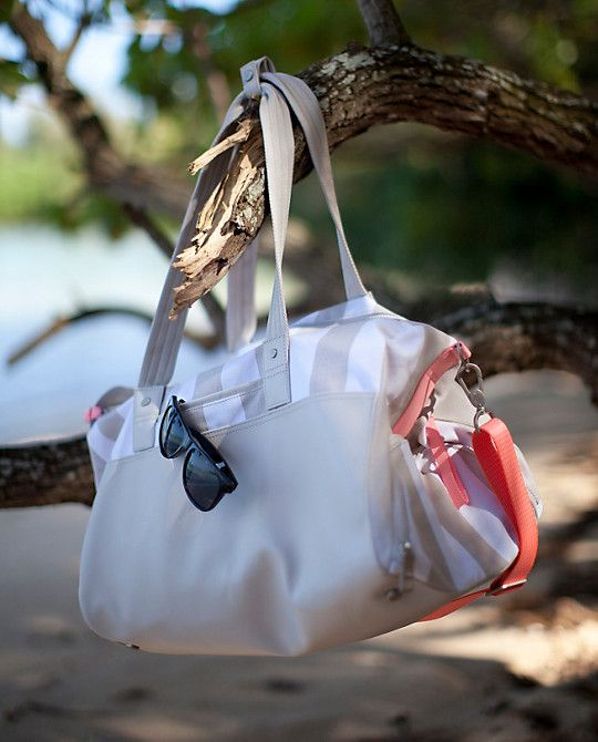 Cute for the gym, yoga and to the beach. Canvas accents and waterproof fabric is a nice touch for this multi purpose bag.