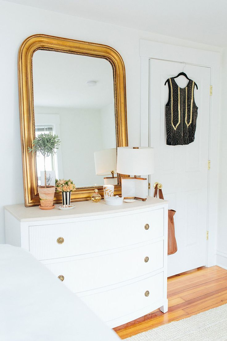 also love the gold mirror... // The Everygirl Cofounders' Chicago Home and Office Tour | The Everygirl