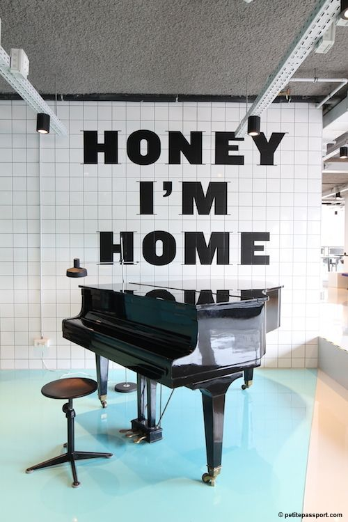 The Student Hotel Den Haag by Petite Passport | black text, white tiles, piano