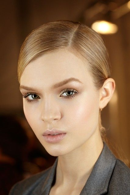 AUTUMN/WINTER 2012-13 - For a show inspired by ballerinas, the make-up had to be equally pretty. Pat McGrath created a glowing complexion, accentuating eyes with bronze eyeshadow before finishing the look with mascara.