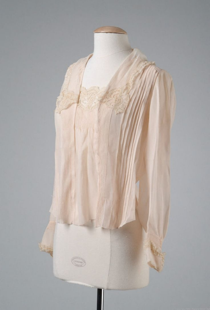 Pleated pink chiffon blouse with cuffs and collar edged in lace 1917