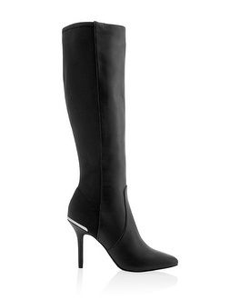 Luxe black boot goes modern and edgy with pointed toe, stretch panel and walk-all-day heel height. Sleek silver inset at the back heel adds for a touch of shine.