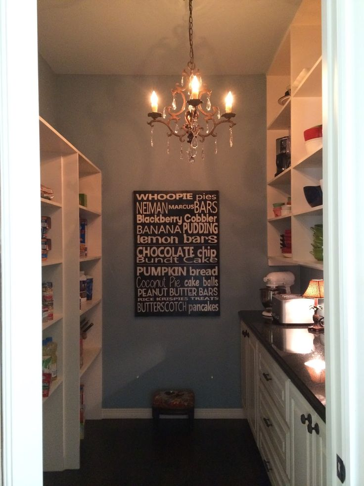 Pantry- open shelves on one side for food and open shelves/drawers on the other side to keep dishes, platters, etc...chandelier too!  ahh in love!