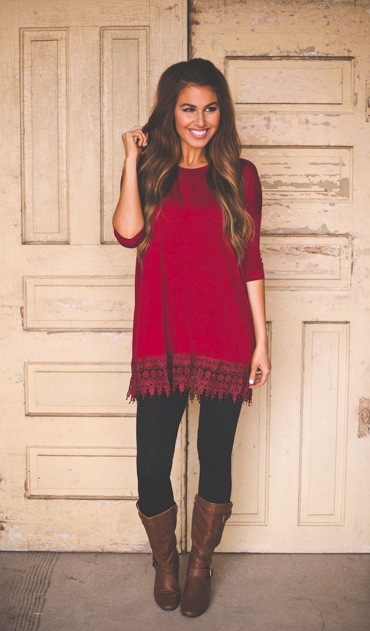 Go for a red tunic and black leggings to achieve a chic look. Polish off the ensemble with dark brown leather knee high boots.  Shop this look for $68:  http://lookastic.com/women/looks/black-leggings-red-tunic-dark-brown-leather-knee-high-boots/4426  — Black Leggings  — Red Tunic  — Dark Brown Leather Knee High Boots