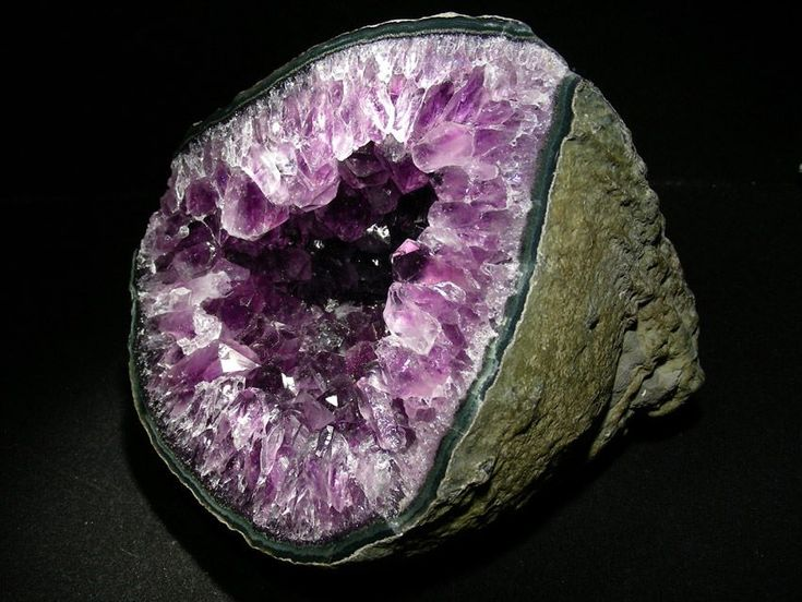 Amethyst Geodes are formed millions of years ago (approximately 130 million years old) in hot lava as gas pockets, fluid silica then penetrated inside, together with combination of iron particles it creates the purple tone. When all the compositions cool off, it produces the quartz crystal inside.      Source: CRYSTALS MINERALS GEMSTONES FOSSILS ROCKS