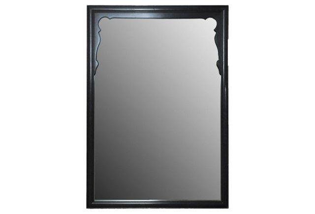 Black Midcentury Mirror over fireplace