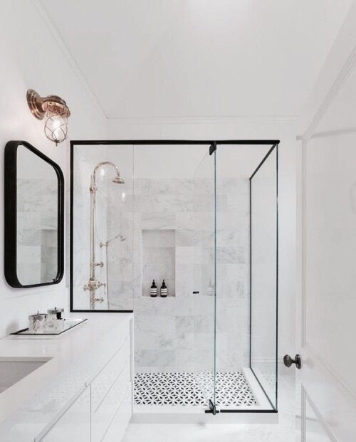 black hardware and white gray marble bathroom glass shower