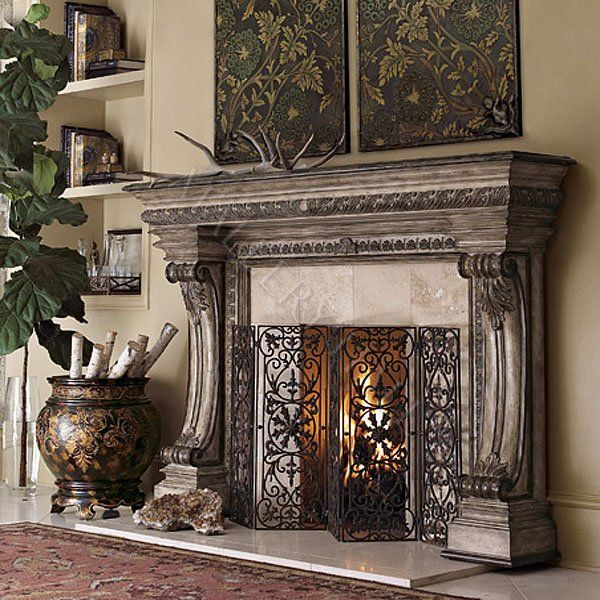 malleryhall.com carved casalla wood fireplace custom designed for our family room.