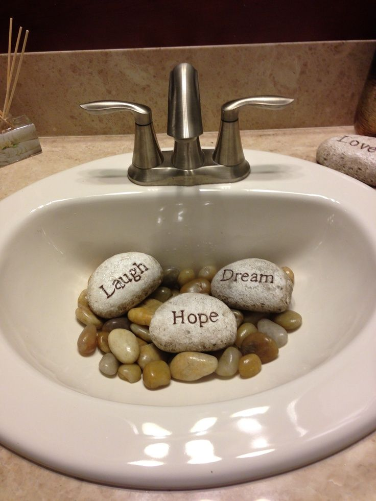∆ Feng Shui...Neat way to cover an unsightly drain. Fill a guest sink partially with smooth stones (large enough not to fall into the drain) and message rocks.