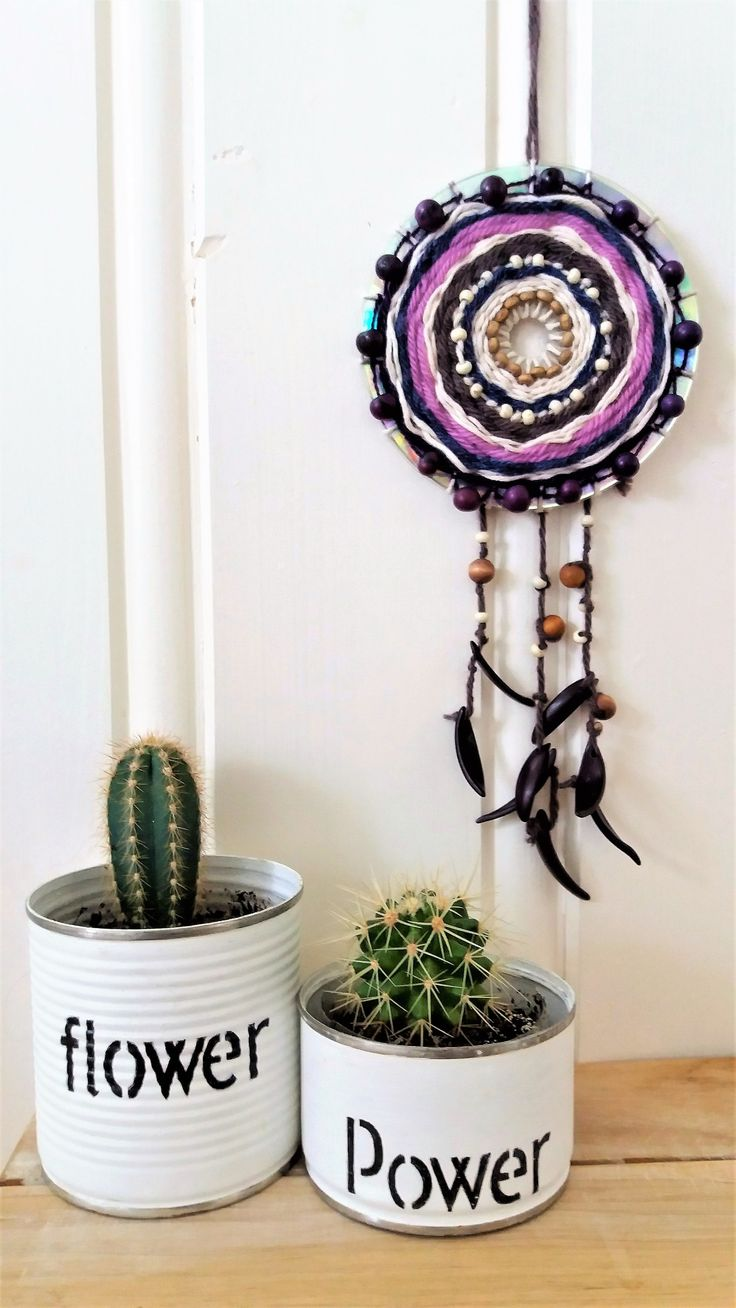 Little dreamcatcher made of an old cd and a couple of painted tin cans