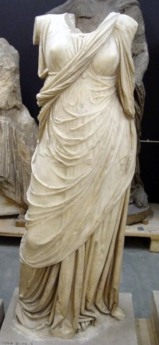 2nd C BC, Turkish  Marble statue of a draped woman. She wears a flimsy chiton over which a himation is draped.