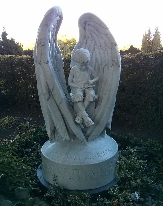 RIP: Tombstone Statue Of Young Boy Playing Pokemon. This is the tombstone statue spotted by Redditor Paramorgue in Lund, Sweden. It features the likeness of a boy who passed away at the far too young age of five, playing Pokemon on a Gameboy Advance SP, which is propped in his lap by a Graveler pokemon. Rest in peace, little boy, hope you're catching 'em all. More pics/closeups through the link.