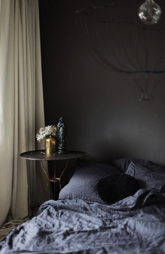 Moody bedroom by Anastasia Benko - the brave black wall looks great.