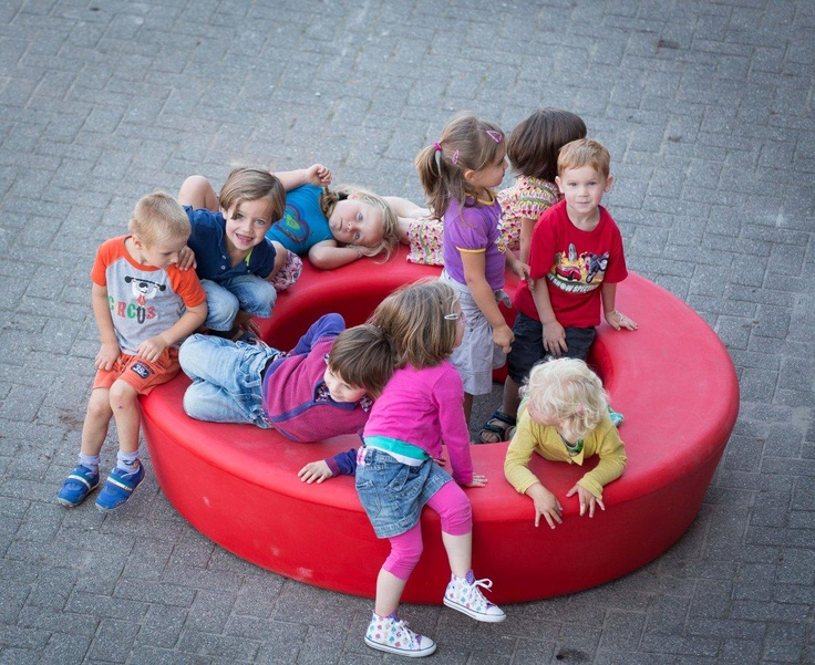 Children playing on LOOP. LOOP is a playful and informal urban element by out-sider, Denmark. LOOP is available in 12 colors. Made in rotation moulded polyethylene, sturdy, UV-resistant, and suitable for complete recycling.