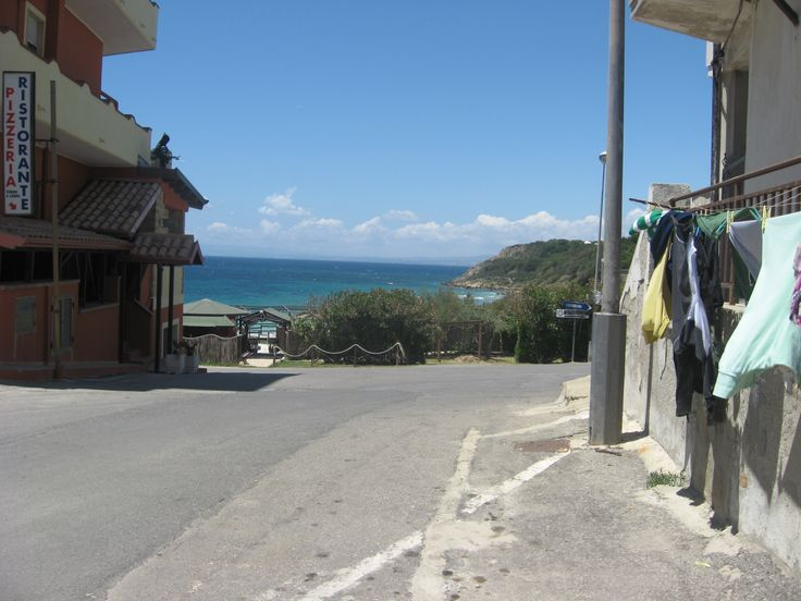 Clotheslines and a view of the Mediterranean sea...typical Italy! In the town of Le Castella, in Calabria, Italy.