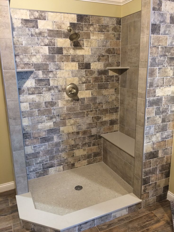 Another awesome shower design by our own Jesse Lewellyn featuring the New York brick look in the color Broadway, Daltile Coastal Tile in Malibu, and Crossville Yin & Yang Bonsai mosaic. Flooring is Cisa Vintage Melange wood look and solid surface is fabricated here by Custom Stone using Color Quartz in Capri