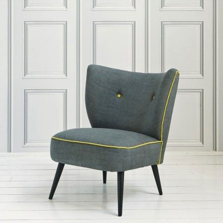 A delightfully comfortable linen occasional chair with contrasting buttons and piping. Also available in a vibrant yellow with contrast piping.