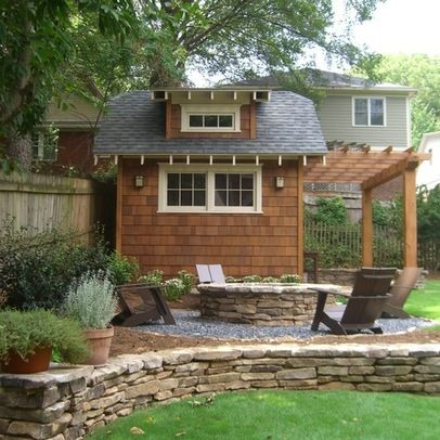 Outdoor firepit and craftsman style outbuilding provide backdrop for ...