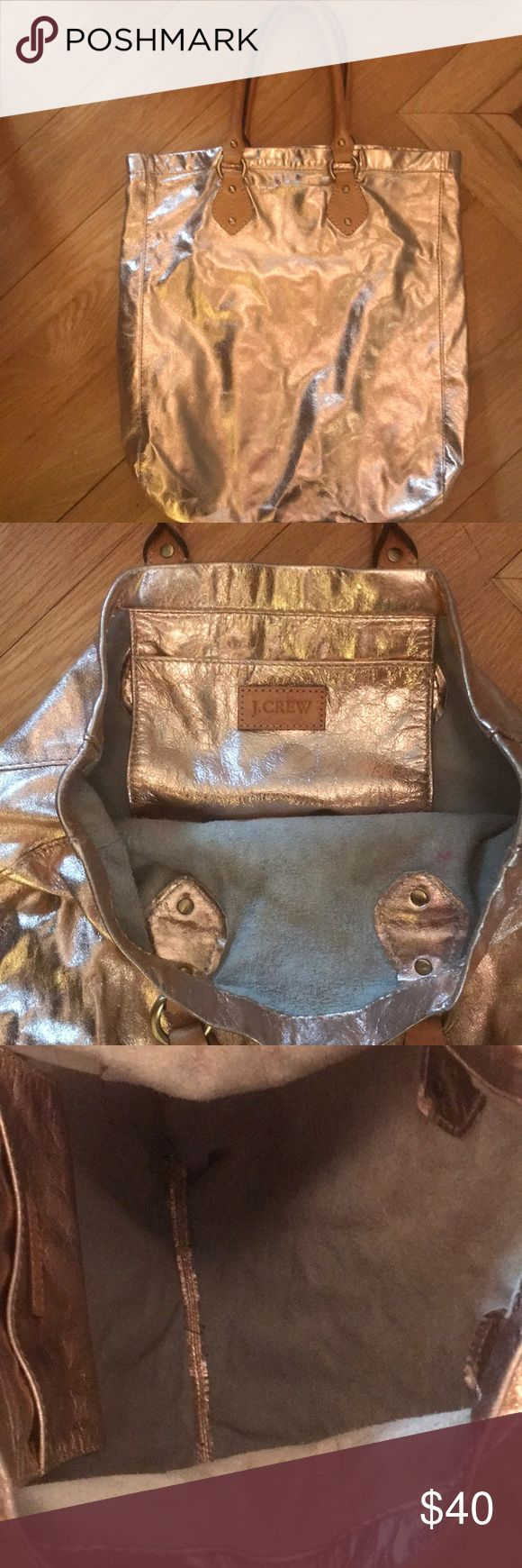 """J.Crew Metallic Rose Gold 100% Leather Bag! J.Crew metallic rose gold leather bag with an inside pocket and tan leather handles. 16"""" height, excellent condition! J. Crew Bags Totes"""
